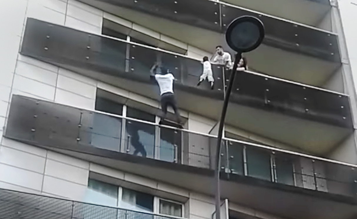 balcony-boy-saved-by-spiderman